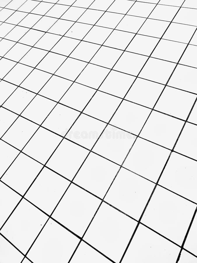 Перспектива приданного квадратную форму кафельного пола стоковые изображения rf