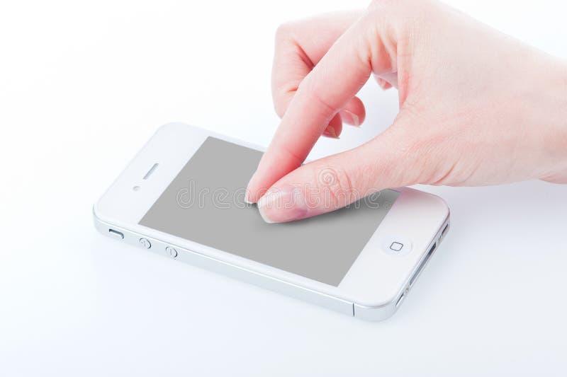 Перста женщин с белым iphone 4 4s стоковые фото