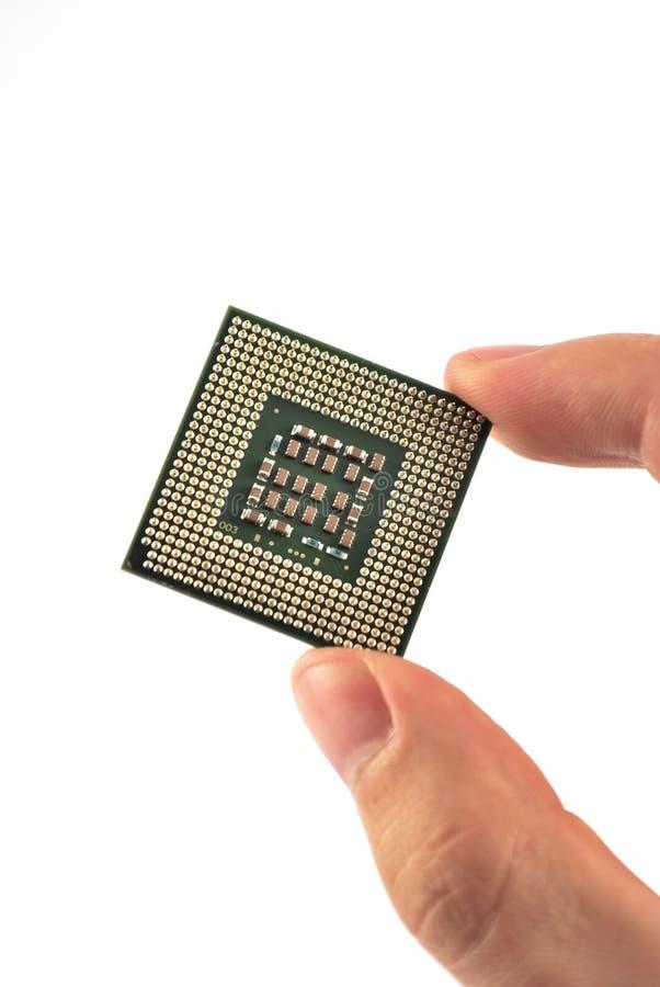 перста компьютера держали микропроцессор стоковая фотография rf