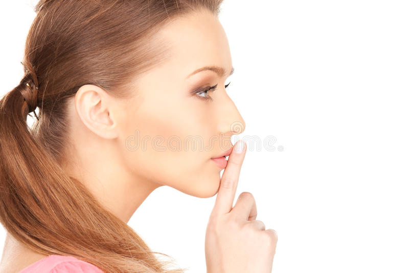 Перст на губах стоковое изображение rf
