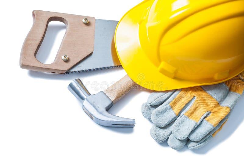 Перчатки молотка с раздвоенным хвостом ручной пилы шлема изолированн стоковые изображения rf