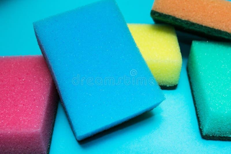 Пестротканые губки на голубой предпосылке стоковые фотографии rf