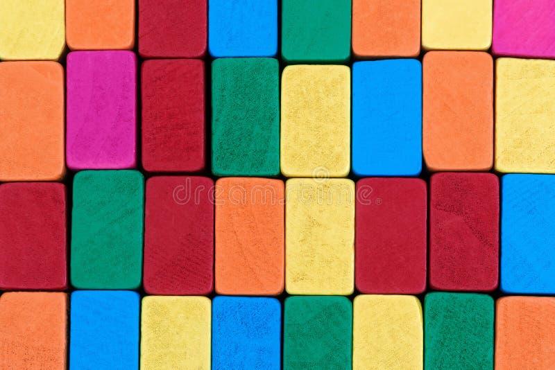 Пестротканые деревянные блоки стоковое фото