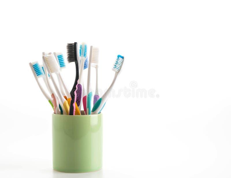 Пестротканые зубные щетки стоковое изображение
