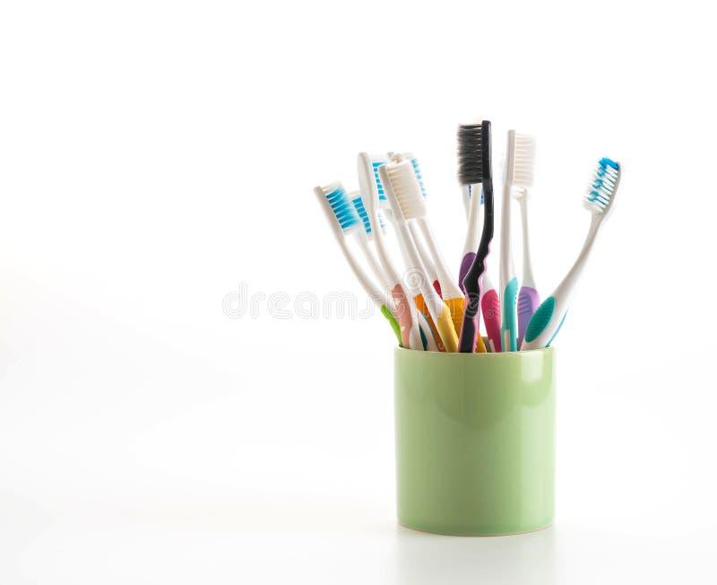 Пестротканые зубные щетки стоковые фото