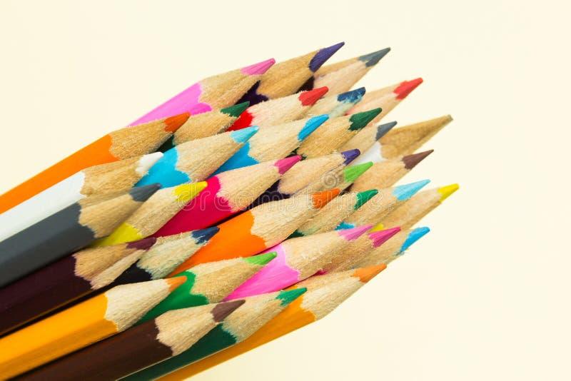 Пестротканые карандаши в группе стоковое фото