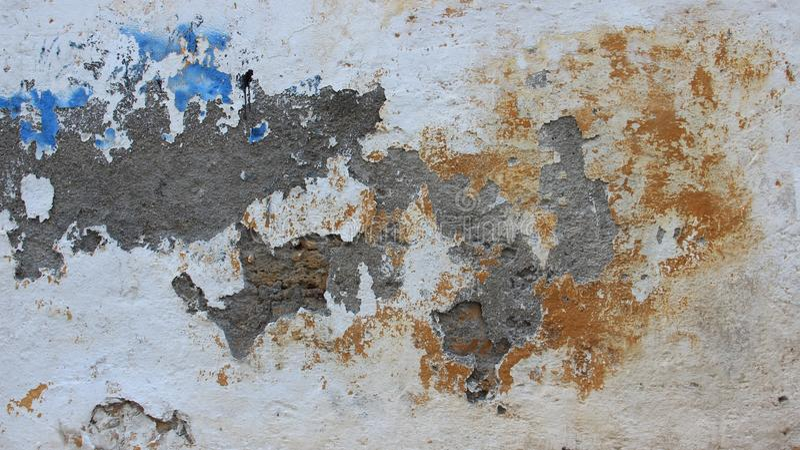 Пестротканые старые стены цемента стоковое фото