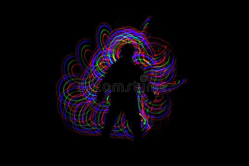 Петли красочной светлой картины следуя человека стоковое фото rf