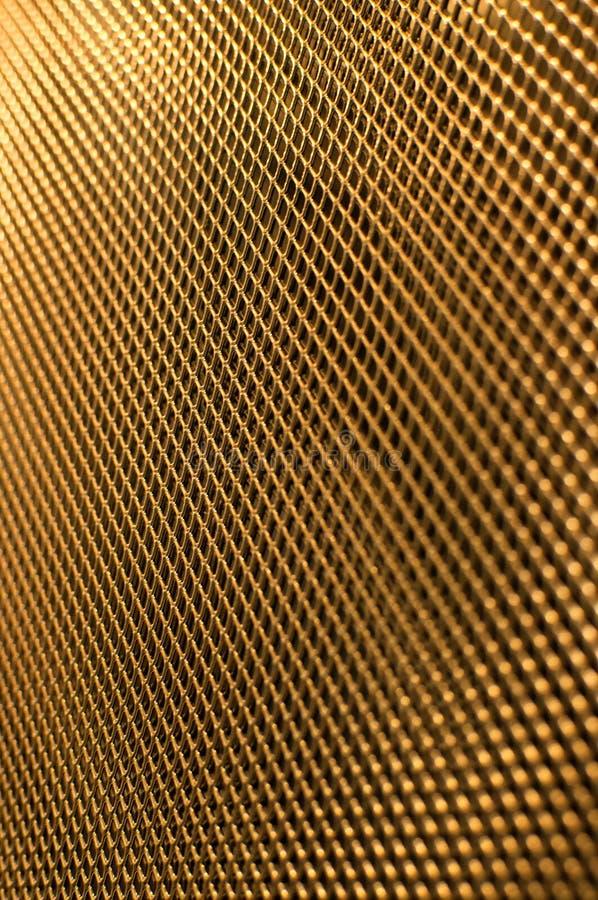 Пефорированная решетка металла золота стоковые изображения