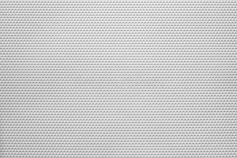 Пефорированная текстура материала покрывает белый цвет стоковая фотография