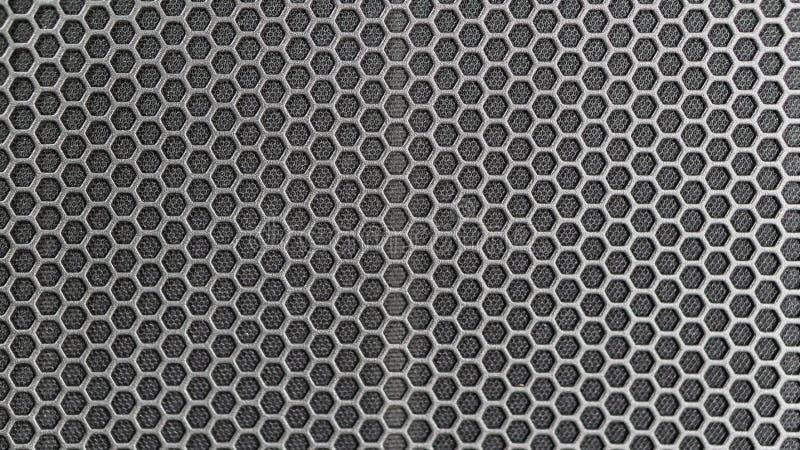 Пефорированная текстура металла, металлический фон, акустическая поверхность гриля диктора стоковое фото