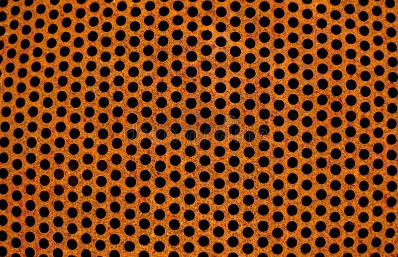 Пефорированные ржавые утюжат текстуру листа Поверхность промышленной сетки Горизонтальная сталь корозии r стоковое фото