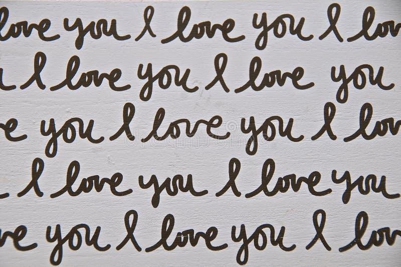 """Печатные слова на древесине блока говоря """"я тебя люблю """" стоковые фотографии rf"""