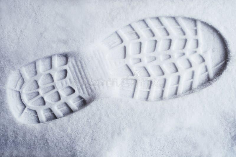 Печать ноги в свежем снеге стоковые фото