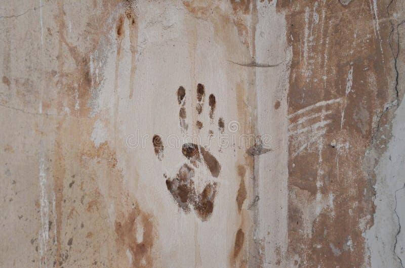 Печать руки на стене стоковая фотография rf