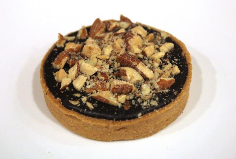 Печенье миндалины шоколада кислое на белой предпосылке плиты стоковые фотографии rf