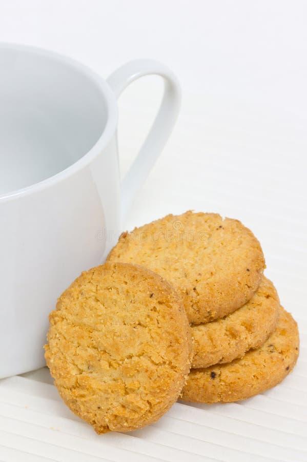 Печенье с кофейной чашкой. стоковые изображения