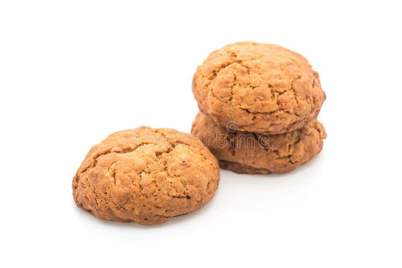 Печенья изюминки овсяной каши на белизне стоковое фото
