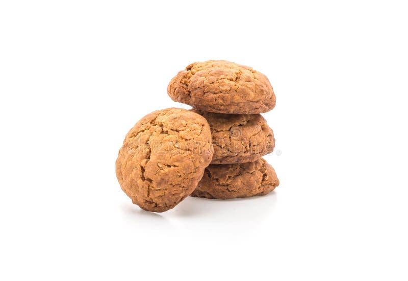 Печенья изюминки овсяной каши на белизне стоковые фото