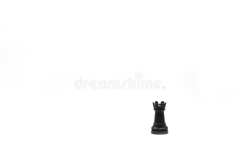 Пешка шахмат, черная башня, изолированная в белой предпосылке стоковая фотография