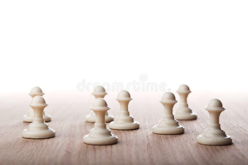 Пешки шахмат стоковые фото