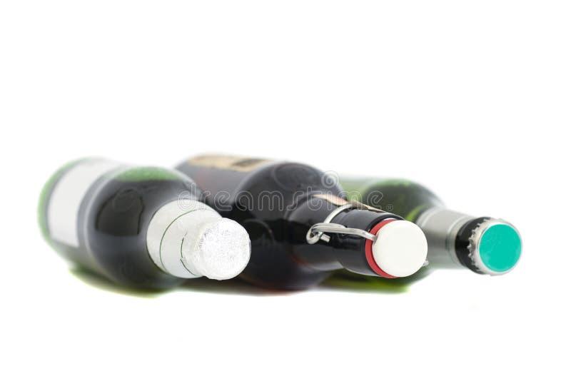 Пивные бутылки изолированные на белизне стоковое изображение rf