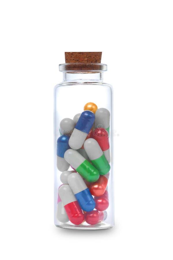 Пилюльки и бутылка стоковые изображения rf