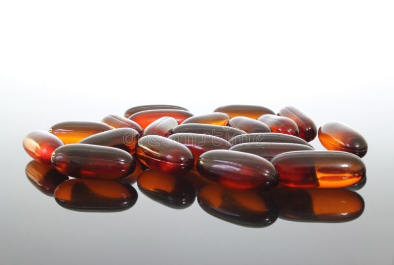 пилюльки масла flaxseed стоковые изображения