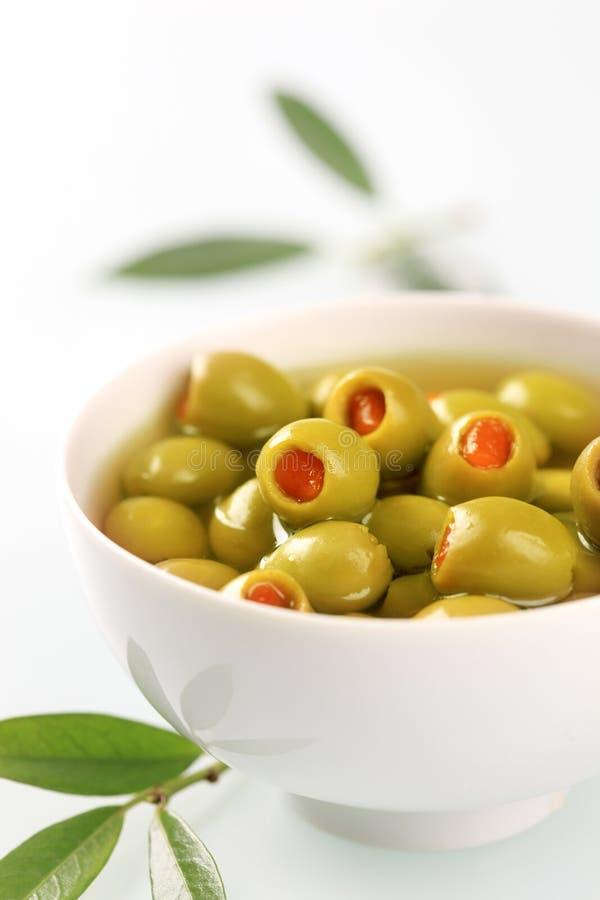 пимент зеленых оливок заполнил стоковые изображения