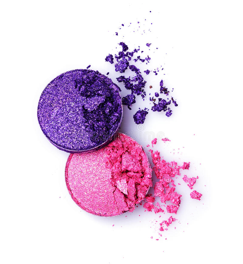 Пинк и фиолет задавили сияющие тени для век на белизне стоковая фотография rf
