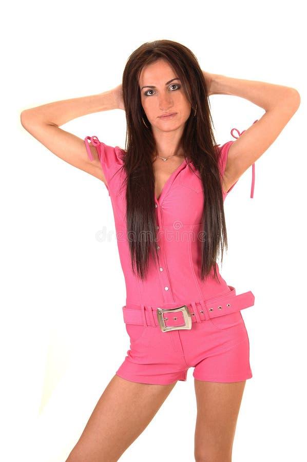 пинк комбинезона девушки стоковое фото