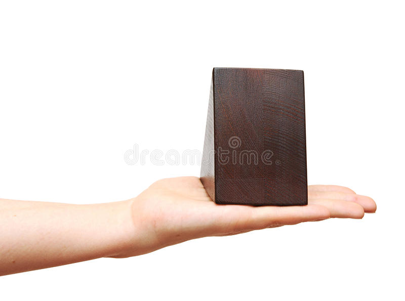 Пирамидка в руке стоковое изображение
