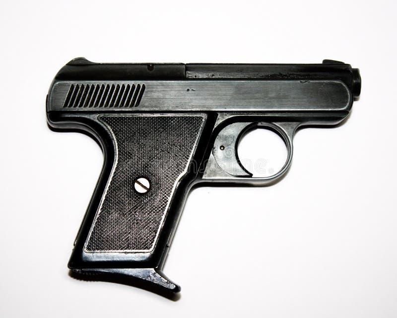 Пистолет оружия на белой предпосылке стоковая фотография rf