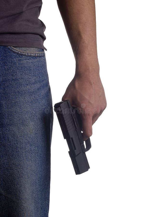 Пистолет в руке стоковое изображение