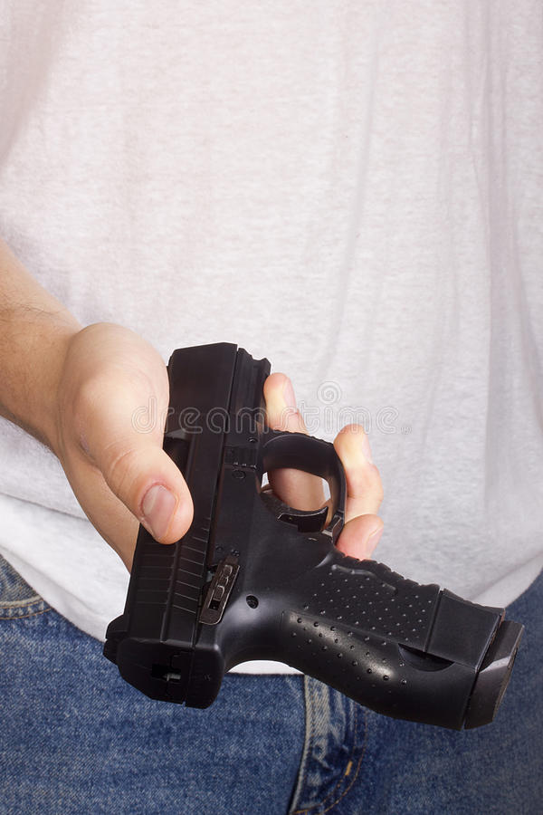 Пистолет в руке стоковые фото