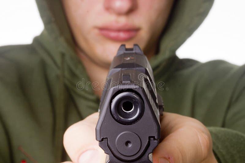 Пистолет в руке стоковое фото rf