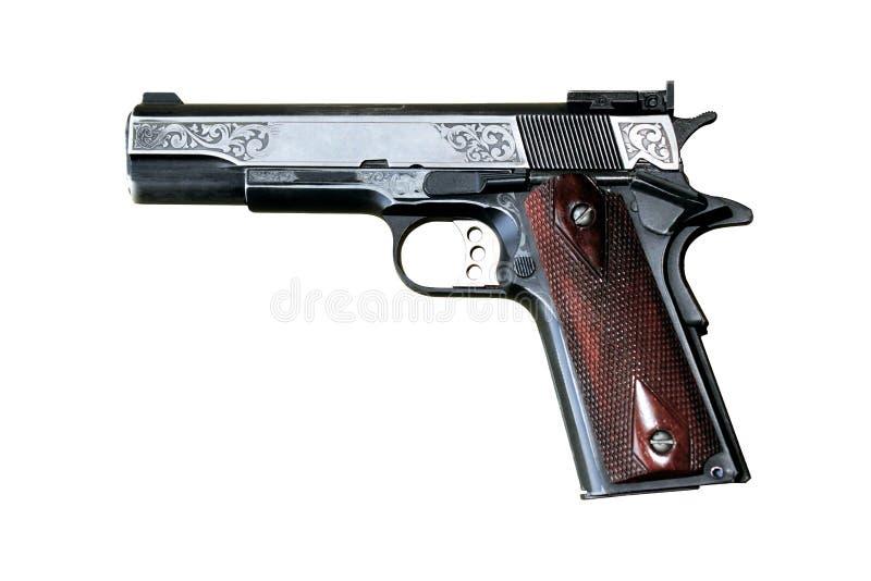 Пистолет на белой предпосылке стоковые изображения