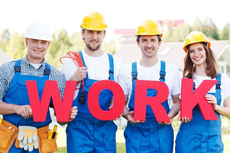 Письма и работники работы стоковое фото