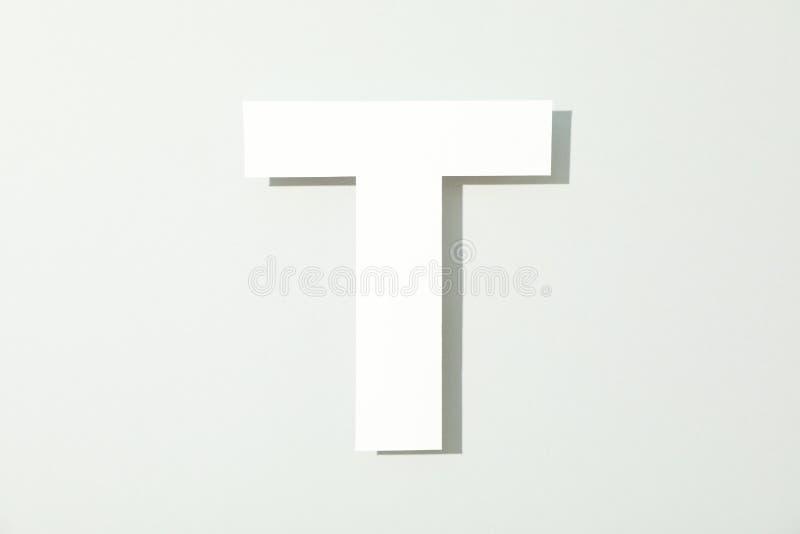 Письмо t на белой предпосылке стоковые изображения rf