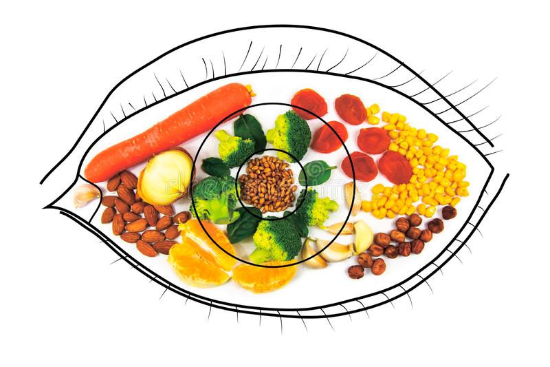 Питание для здоровья глаз Здоровая пища Морковь, сушеные абрикосы, чеснок, брокколи, орехи стоковые фото