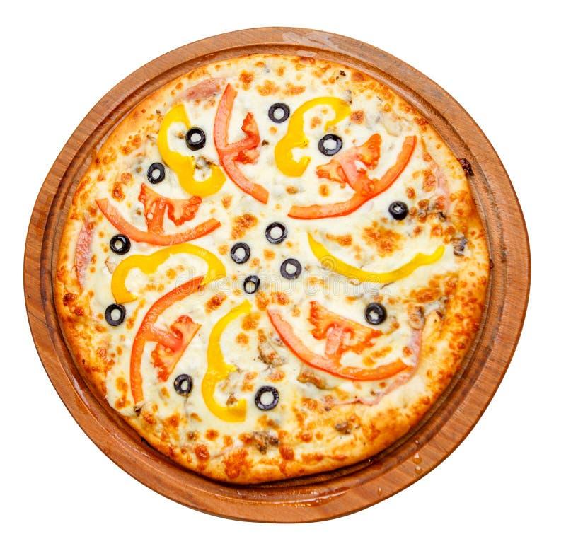Пицца на деревянной плите стоковые фотографии rf