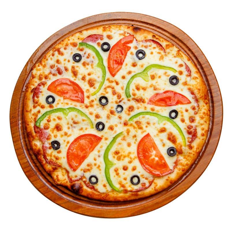 Пицца на деревянной плите стоковое изображение