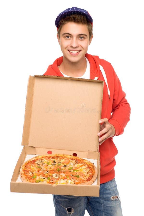 пицца работника доставляющего покупки на дом стоковые изображения rf