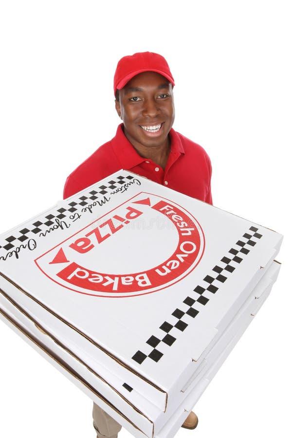 пицца работника доставляющего покупки на дом стоковое фото rf