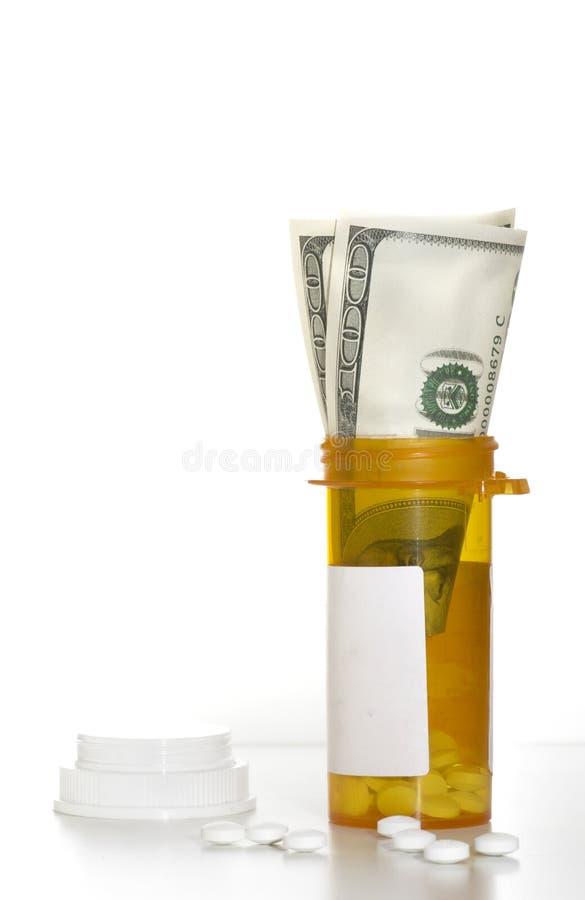 Пилюльки рецепта и наличные деньги денег стоковое фото rf