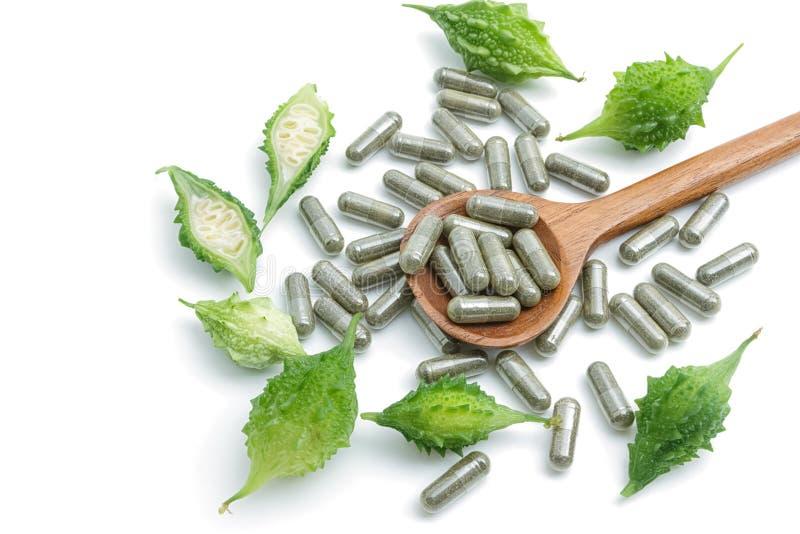 Пилюльки травы с горькой тыквой, гомеопатической медициной стоковое изображение rf