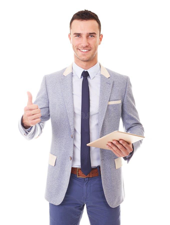 ПК планшета удерживания человека и делает большой палец руки жеста вверх стоковая фотография