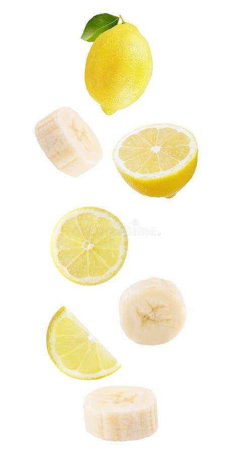 плавать изолированный на белых плодах и бананах лимона предпосылки стоковое фото rf
