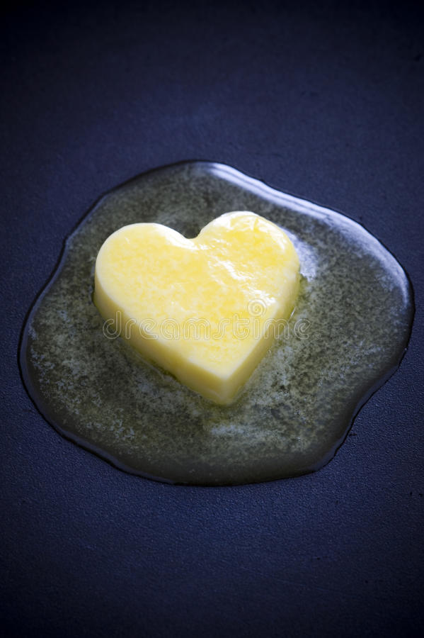 плавить сердца масла стоковая фотография