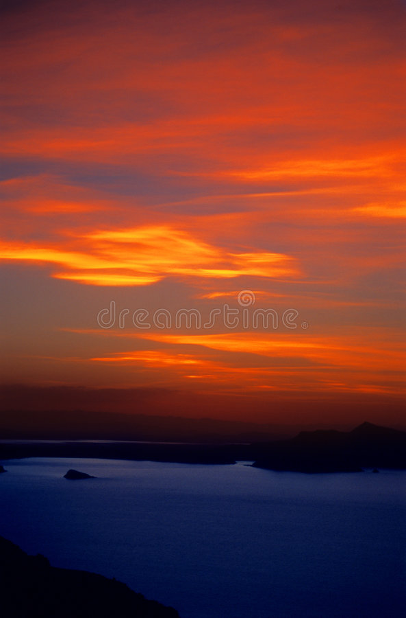 пламенистое озеро над titicaca захода солнца Перу стоковое фото rf